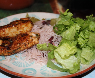 Jamaican jerk chicken, rice and peas and salad