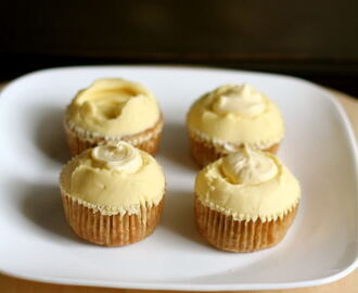 vanilla cupcakes with mango swiss meringue buttercream.