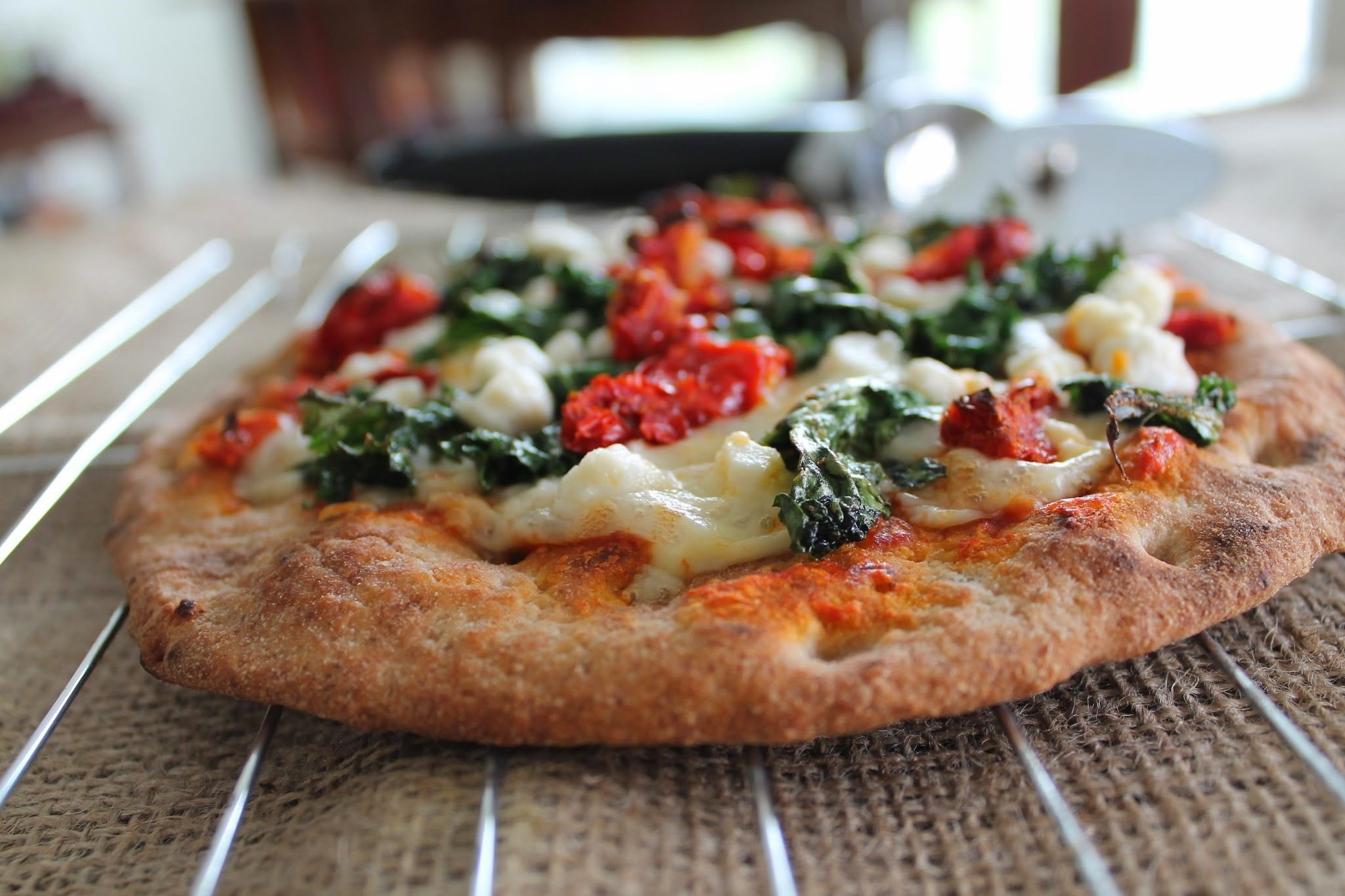 Flatbread Pizza with Sundried Tomatoes, Kale, & Goat Cheese