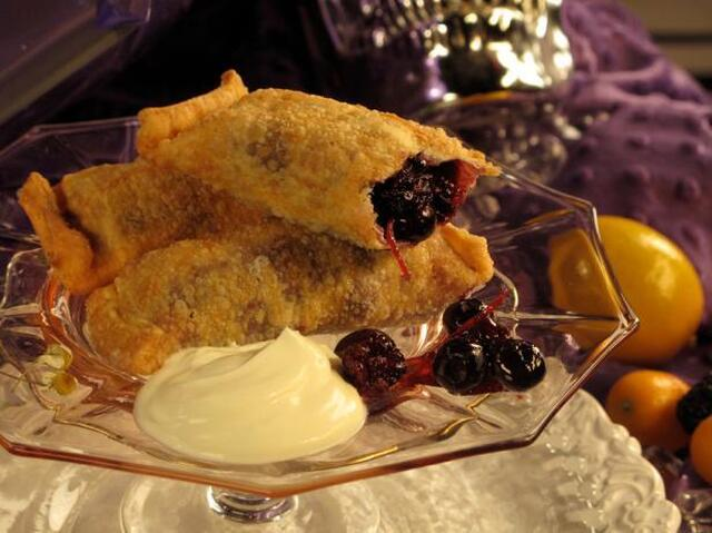 Black and Blueberry Dumplings with Vanilla Ice Cream and Chocolate Sauce