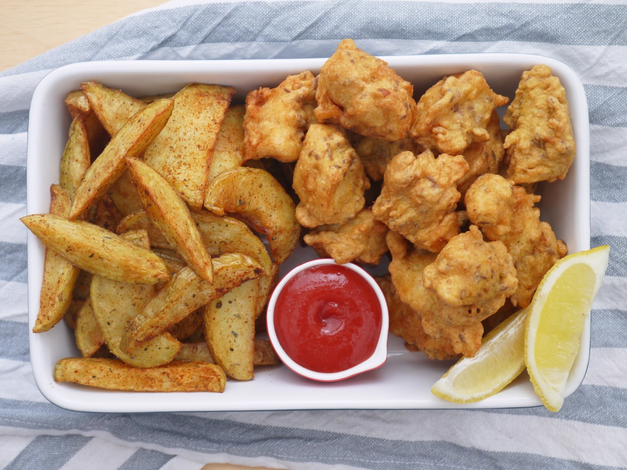 Spicy Fish Nuggets with Creole Potato Wedges.