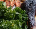 Blackened chicken drumstick with sweet potato fries, kale salad & yogurt sauce