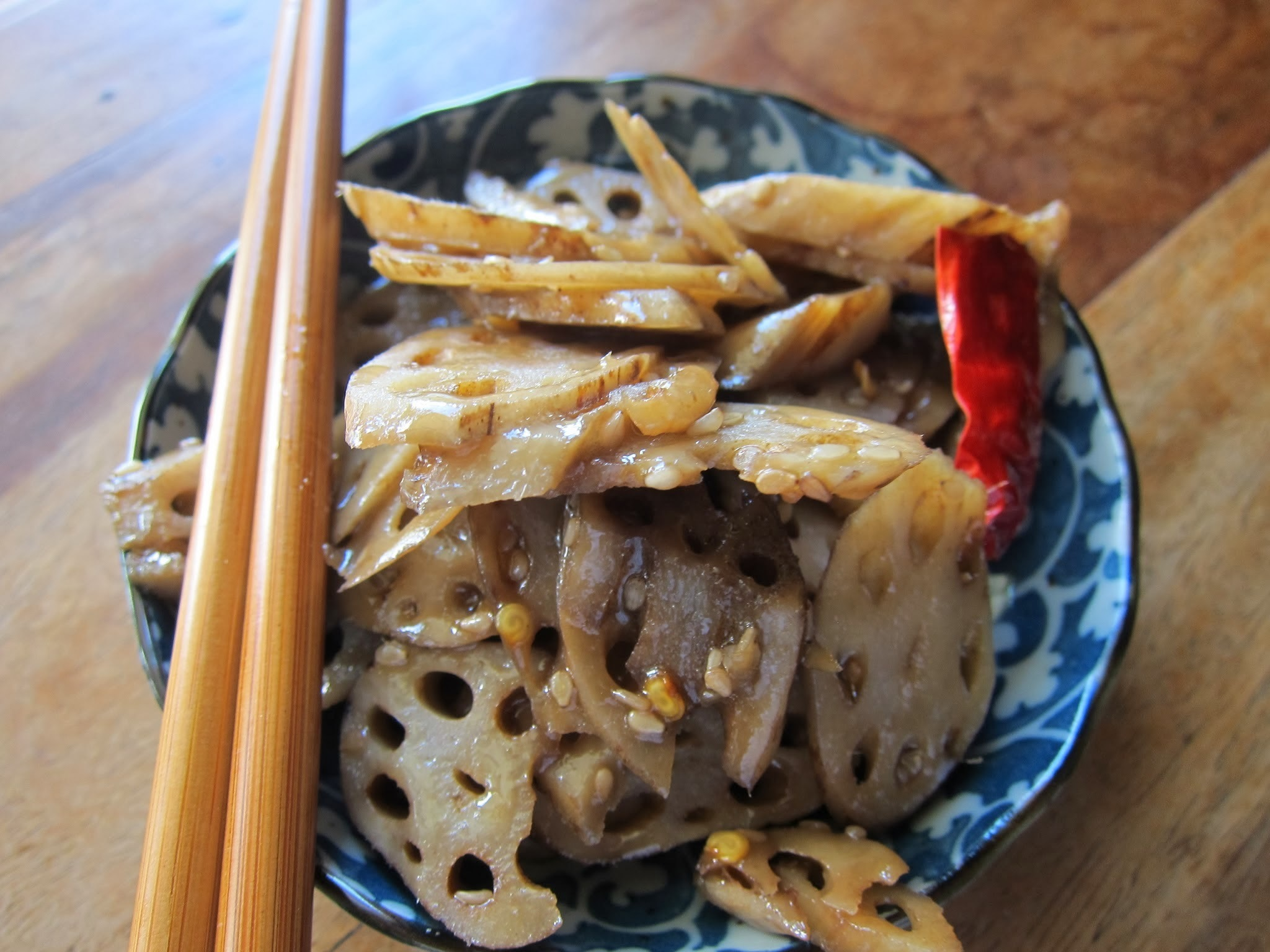An Asian Feast - Lotus Stem in a sweet, sticky, sesame sauce.
