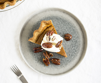 Sweet potato pie with whipped cream and maple pecans