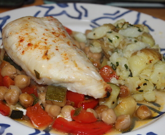 Baked hake with chickpeas, red pepper and courgette with crushed new potatoes