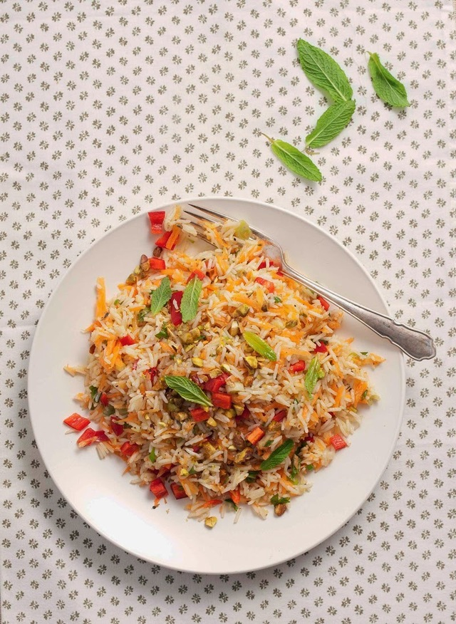 Aromatic rice and carrot salad with nuts and fresh spearmint