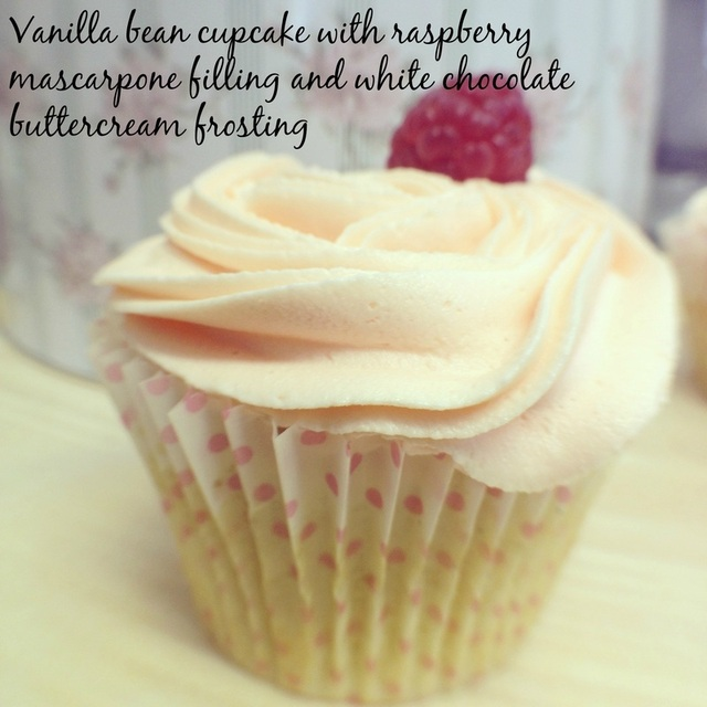 Vanilla bean cupcakes with raspberry mascarpone filling and white chocolate buttercream frosting