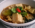 Asian fusion; udon noodle soup with tofu and korean miso sautéed enoki mushroom