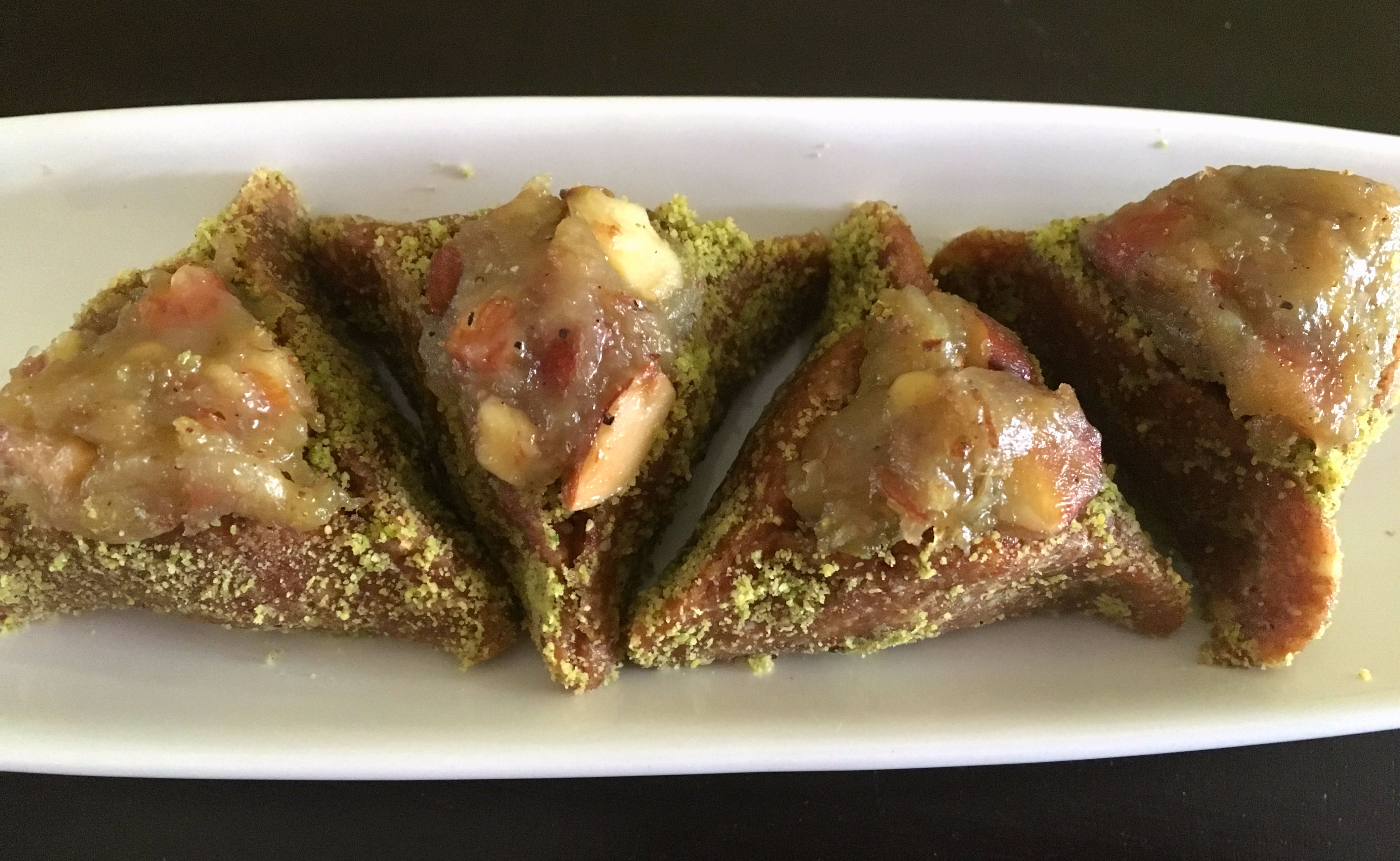 Delicious Date and Almond Hamantaschen stuffed with Banana Halwa!