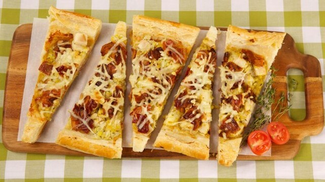 Bacon, Apple and Leek Tart 	             slices bacon leeks cloves garlic dry white wine sweet-tart apples chopped fresh thyme pinch salt pinch pepper whipping cream frozen rolled butter puff pastry milk Dijon mustard shredded Gruyère cheese