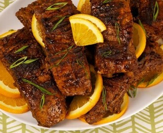 Orange Black Bean Ribs 	             pork back ribs or pork side ribs black bean garlic sauce grated orange rind orange juice liquid honey rice vinegar or cider vinegar salt green onion