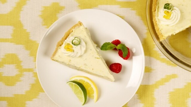 Lemon Lime Refrigerator Cheesecake 	             crushed shortbread cookies butter pkg cream cheese whipping cream sweetened condensed milk finely grated lemon rind finely grated lime rind lime juice granulated sugar lemon rind lime rind