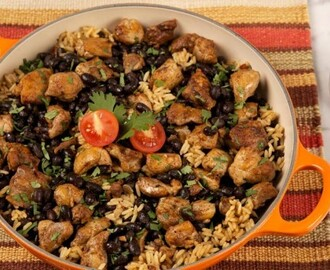 Chipotle Chicken With Rice and Beans 	             boneless skinless chicken thighs chili powder salt pepper vegetable oil onion cloves garlic long-grain white rice chipotle chili in adobo sauce sodium-reduced chicken broth black beans chopped fresh cilantro