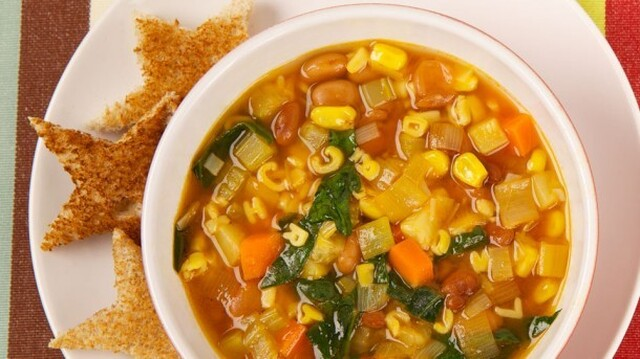 Alphabet Soup 	             olive oil carrot rib celery cloves garlic small zucchini vegetable broth bottled strained tomatoes pepper alphabet pasta frozen corn kernels pinto beans or chickpeas packed fresh spinach