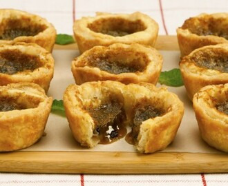 Not-So-Gooey Butter Tarts 	             all-purpose flour salt cold butter lard or butter egg yolk vinegar water packed brown sugar corn syrup egg butter vanilla vinegar pinch salt currants or raisins or chopped pecans or shredded coconut