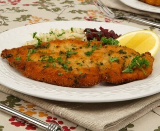 Chicken Schnitzel 	             boneless skinless chicken breasts all-purpose flour each salt and pepper dried thyme egg dry bread crumbs finely chopped fresh parsley vegetable oil cloves garlic anchovy paste chicken stock lemon juice cornstarch