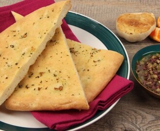 Garlic Flatbread 	             pinch granulated sugar warm water active dry yeast or quick-rising yeast extra-virgin olive oil all-purpose flour salt garlic clove dried mint or dried oregano