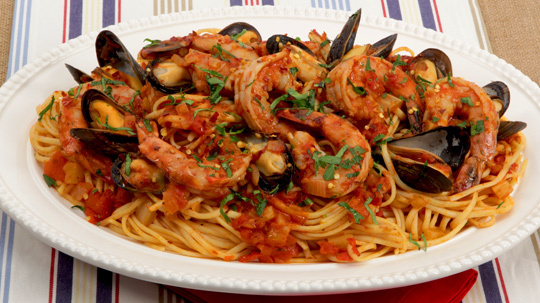 Seafood Linguine 	             olive oil onion diced fennel bulb cloves garlic bay leaves salt whole tomatoes dry white wine tomato paste paprika dried Italian herb seasoning hot pepper flakes mussels large shrimp linguine minced fresh parsley