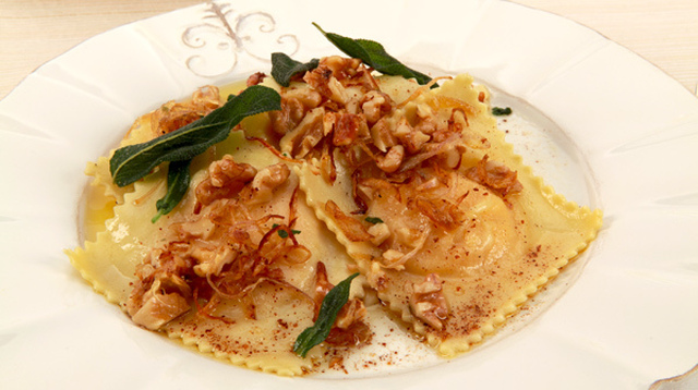 Squash Ravioli with Sage and Walnut Butter 	             butternut squash smooth ricotta cheese grated Parmesan cheese salt white pepper nutmeg butter thinly sliced shallots fresh sage leaves coarsely chopped walnuts pepper flour salt eggs