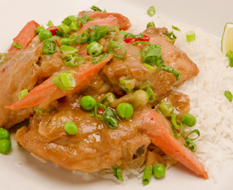 Chicken in Peanut Sauce 	             skinless chicken thighs carrots onions cloves garlic water smooth peanut butter soy sauce ginger hot pepper flakes frozen peas white wine vinegar green onions chopped unsalted peanuts