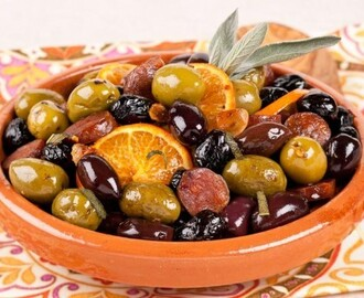 Warm Mixed Olives and Chorizo 	             oz smoked chorizo or other smoked sausage navel orange Tbsp extra-virgin olive oil cup unpitted oil-cured black olives cup unpitted large green olives cloves garlic tsp hot pepper flakes tbsp fresh sage leaves