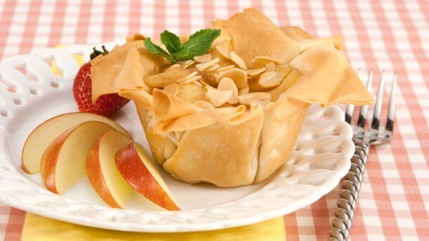 Phyllo Cluster Apple Tarts 	             apples liquid honey cinnamon grated lemon rind sheets phyllo pastry canola oil 25 mL sliced almonds