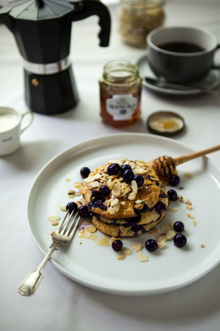 Oaty blueberry pancakes with toasted almonds and Manuka honey