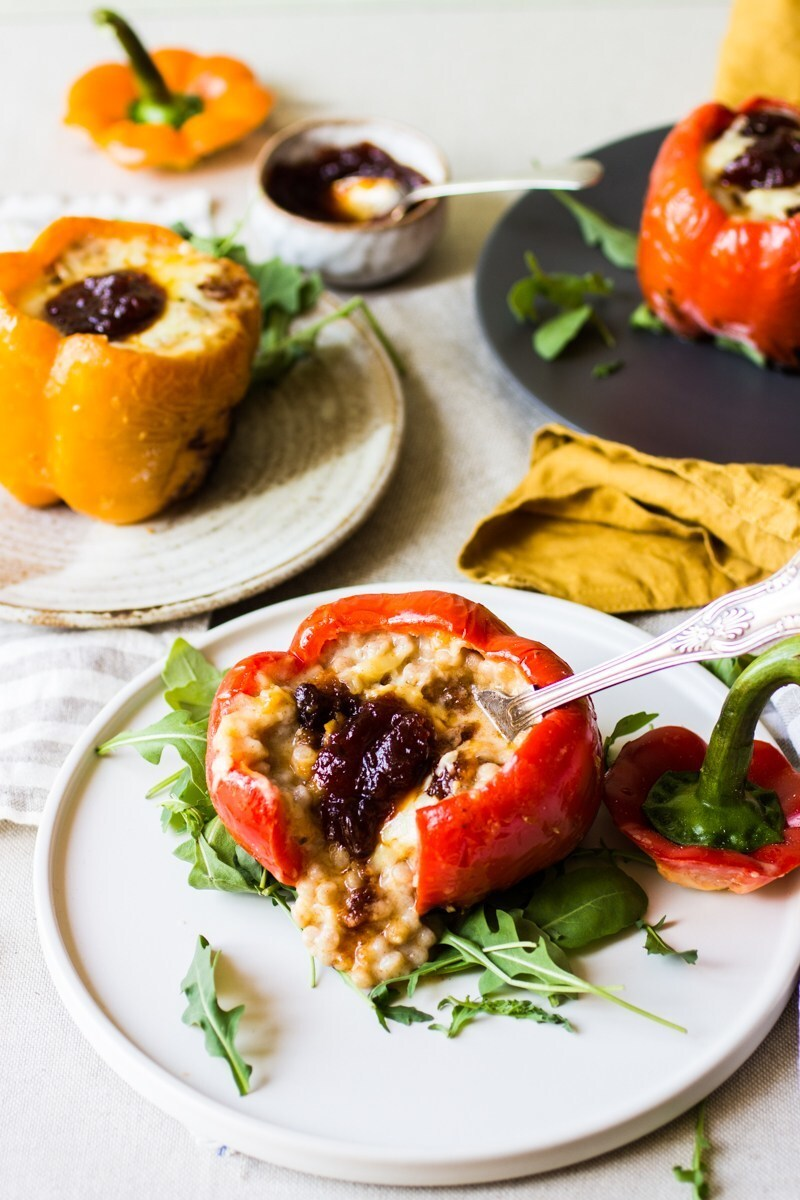 Stuffed peppers with couscous in cheese sauce