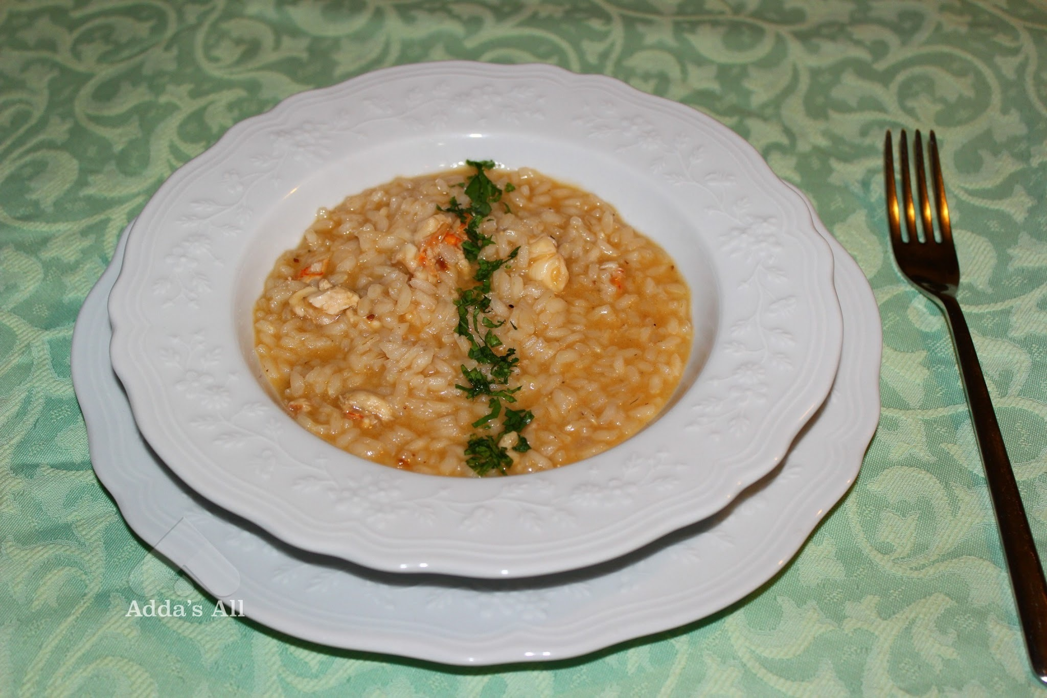 Risotto all'aragosta e champagne