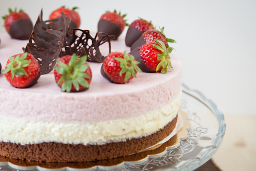 Triple-layer Bavarian cream cake with strawberries and white chocolate