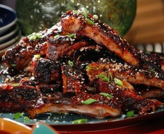 Asian Spice Rubbed Ribs with Pineapple-Ginger BBQ Sauce and Black and White Sesame Seeds