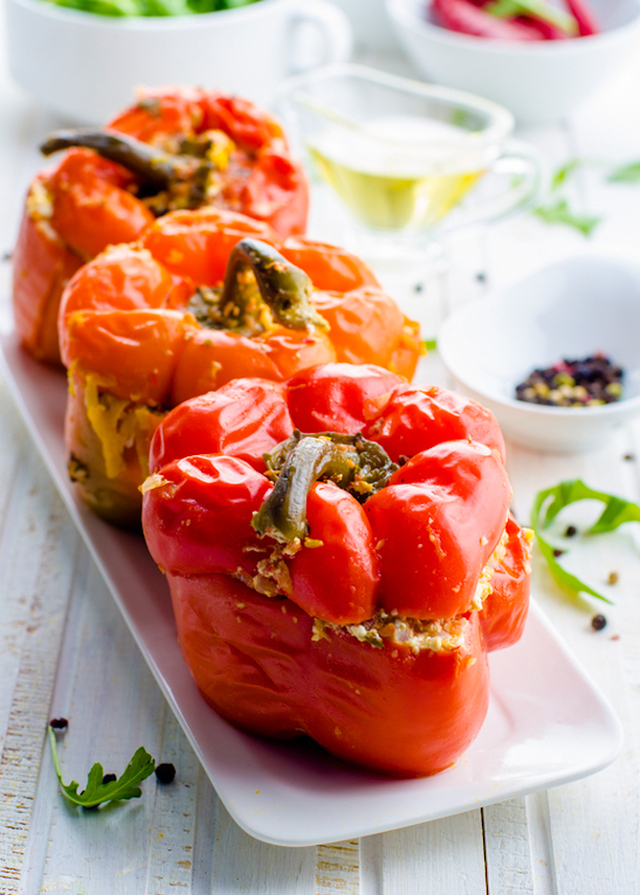 Black Bean and Quinoa Stuffed Red Peppers with Avocado Lime Sauce