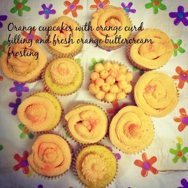 Orange cupcakes with orange curd filling and fresh orange buttercream frosting
