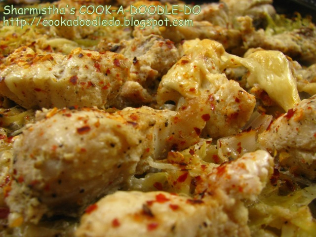 Baked Fish (Bhetki) on a bed of grated Cabbage