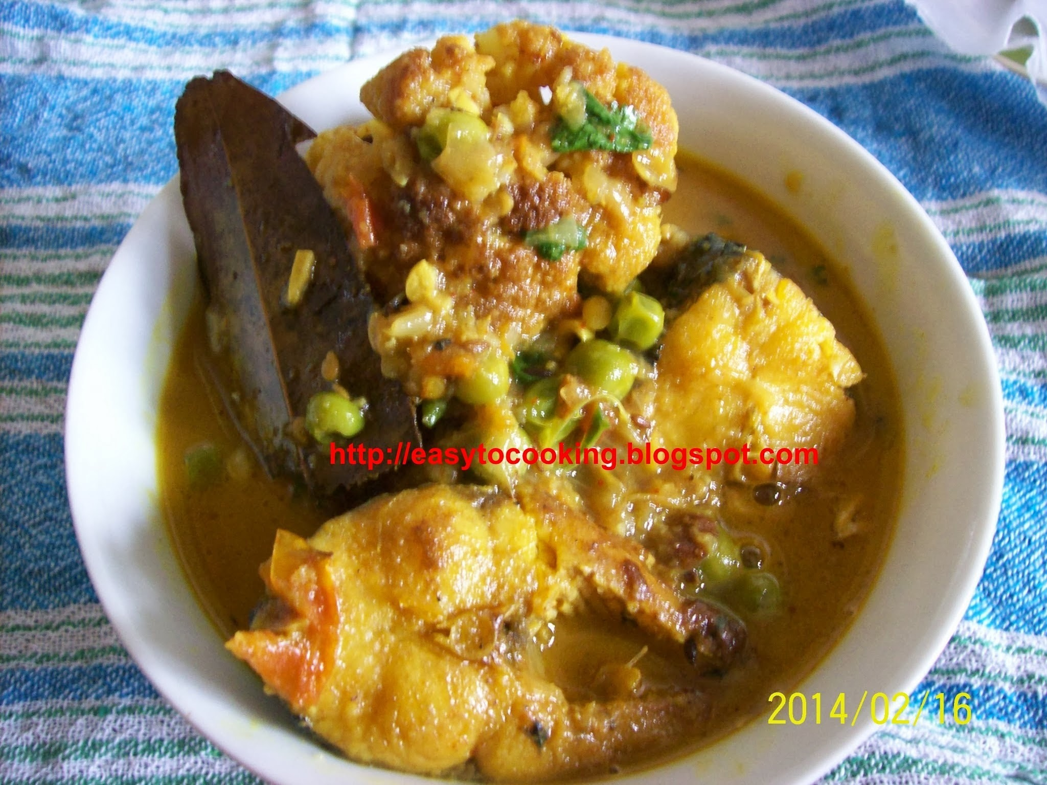 Fish curry (Macher jhol) with cauliflower