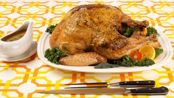 Roast Turkey With Hazelnut Gremolata 	             whole hazelnuts chopped fresh parsley cloves garlic extra-virgin olive oil grated orange zest slices prosciutto salt pepper dry white wine sodium-reduced chicken broth all-purpose flour