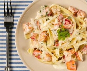 Lobster Fettuccine 	             cooked lobsters fettuccine extra virgin olive oil minced cloves of garlic minced shallot salt pinch hot pepper flakes dry white wine finely chopped fresh parsley whipping cream