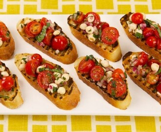 Grilled Panzanella Bites 	             olive oil red wine vinegar or white wine vinegar cloves garlic salt pepper mini pearl bocconcini finely chopped red onion large baguette halved grape tomatoes chopped fresh basil