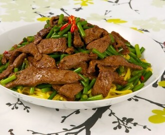 Chinese Beef, Garlic and Scape Stir-fry 	             soy sauce cornstarch minced gingerroot sesame oil cloves garlic pepper top sirloin grilling steak garlic scapes small hot red pepper vegetable oil salt beef stock