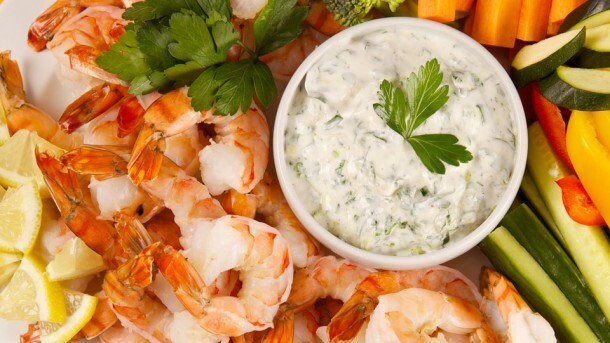 Shrimp With Lemon Herb Dip 	             tsp olive oil green onions cloves garlic 2% plain Greek yogurt reduced-fat mayonnaise chopped fresh basil chopped fresh parsley pinch salt pinch pepper tsp grated lemon zest tsp lemon juice frozen cooked large shrimp