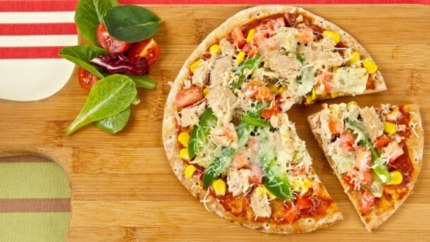 Barbecued Tuna Pizzas 	             pizza or pasta sauce whole wheat Greek pitas or plain pita pockets plum tomatoes sweet green pepper corn kernels marinated artichoke hearts tuna pepper shredded Asiago or provolone cheese