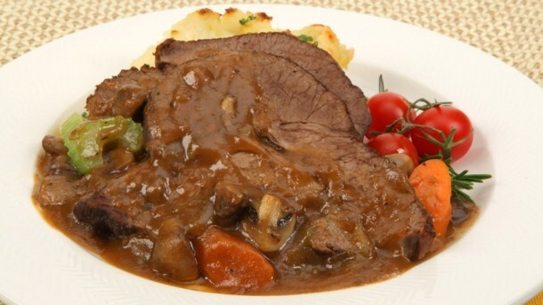 Mushroom Pot Roast 	             boneless beef cross rib pot roasts salt pepper vegetable oil onion carrots celery stalks cloves garlic dried marjoram dried oregano button mushrooms sodium-reduced beef stock tomato paste Worcestershire sauce all-purpose flour