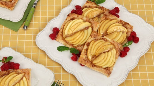Almond Apple Tarts 	             Frozen butter puff pastry egg finely chopped toasted almonds granulated  sugar cinnamon apple jelly