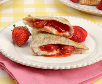 Strawberry Cheesecake Turnovers 	             hulled strawberries granulated sugar cornstarch lemon juice cinnamon frozen butter puff pastry egg Demerara sugar cream cheese icing sugar vanilla