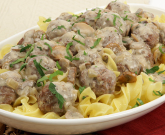 Meatball Stroganoff 	             lean ground beef fresh bread crumbs egg Worcestershire sauce clove garlic salt pepper vegetable oil onion sliced mushrooms dried thyme sodium-reduced beef stock Dijon mustard light sour cream cornstarch