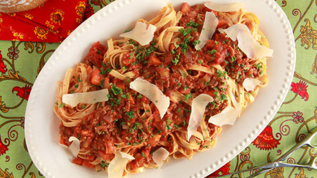 Bolognese Beef Sauce 	             lean ground beef pancetta or bacon onion cloves garlic carrots celery stalks dried thyme each salt and pepper fennel seeds milk whole tomatoes crushed tomatoes red wine bay leaf pinch granulated sugar chopped fresh parsley