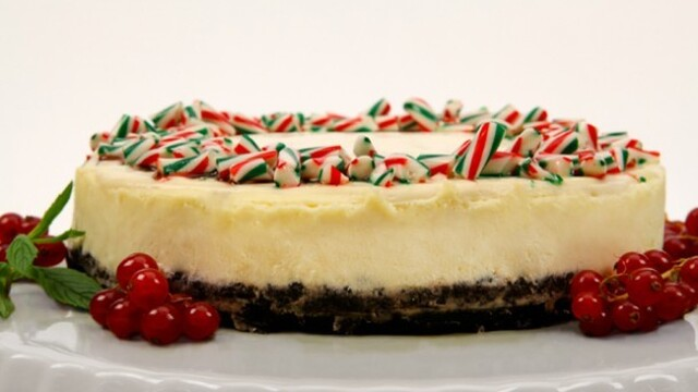 Candy Cane Cheesecake 	             pkg cream cheese granulated sugar eggs sour cream lemon juice peppermint extract chocolate wafer crumbs butter sour cream granulated sugar vanilla coarsely crushed candy canes