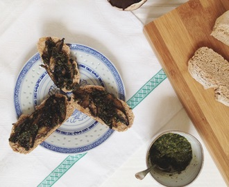 Mushrooms on toast with carrot top pesto