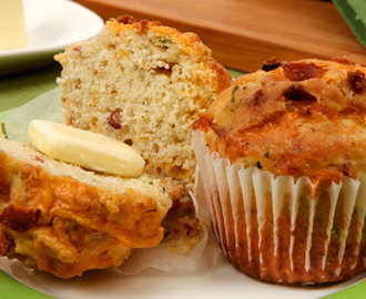 Cheddar Bacon Muffins 	             strips bacon shredded old cheddar cheese all-purpose flour granulated sugar baking powder pepper salt milk vegetable oil sliced green onions sour cream eggs