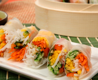 Vegetarian Salad Rolls 	             rice stick vermicelli English cucumber sweet red pepper large carrot mango rice paper wrappers large mint or basil leaves finely chopped roasted peanuts sweet Thai chili sauce lime juice each rice wine vinegar and water